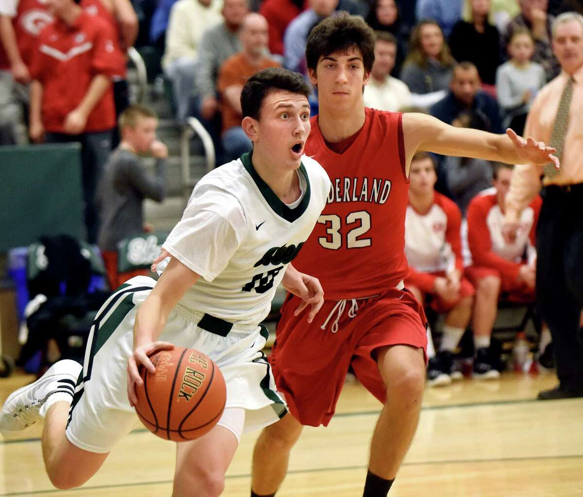 Shen's Luke Hicks, left, controls the ball as Guilderland's George Marinopoulos defends during their basketball game on Friday, Dec. 11, 2015, at Shenendehowa High in Clifton Park, N.Y. (Cindy Schultz / Times Union)