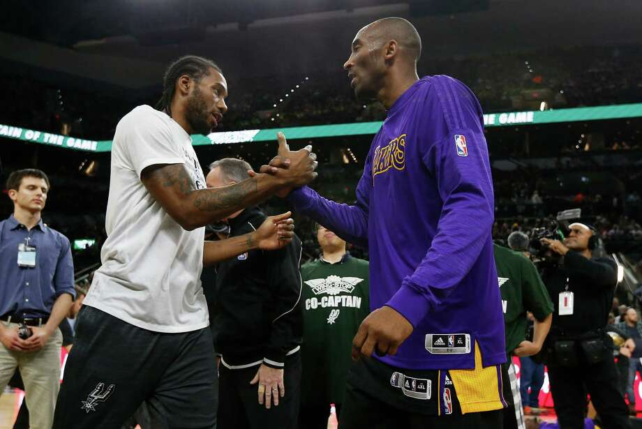 Spurs' Kawhi Leonard (left) and Los Angeles Lakers' Kobe Bryant (right) shake hands before the start of the game at the AT&T Center on Friday, Dec. 11, 2015. Bryant recently announced his intention to retire at the end of the season.(Kin Man Hui/San Antonio Express-News) Photo: Kin Man Hui, Staff / San Antonio Express-News / ©2015 San Antonio Express-News