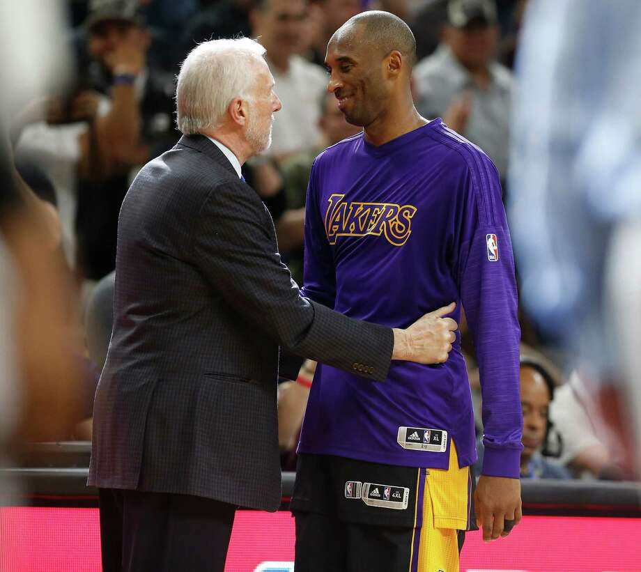 Spurs head coach Gregg Popovich shares a moment with Los Angeles Lakers' Kobe Bryant (24) at the end of the game at the AT&T Center on Dec. 11, 2015. Spurs defeated the Lakers, 109-87. Photo: Kin Man Hui /San Antonio Express-News / ©2015 San Antonio Express-News