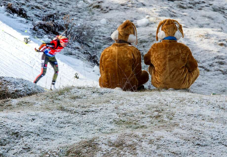 German biathlon fans watch the second placed German competitor Maren Hammerschmidt  during the women's 7,5 km sprint event during IBU World Cup in biathlon in Hochfilzen, Austria on December 11, 2015. Photo: Joe Klamar, AFP / Getty Images