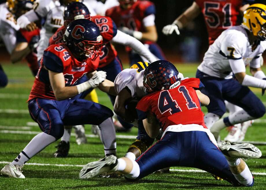Campolindo player Logan MacDonald (center) tackles Milipitas player Tariq Bracy during the first quarter of theNorthern California 3-AA championship game between Milipitas and Campolindo in Moraga, California on Friday, December 11, 2015.during the  Northern California 3-AA championship game between Milipitas and Campolindo in Moraga, California on Friday, December 11, 2015. Photo: Gabrielle Lurie, Special To The Chronicle