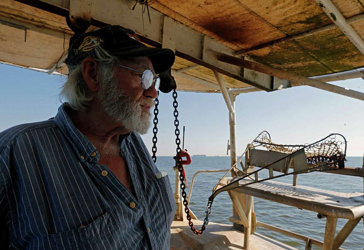 Oyster boat Captain Kenny Watkins looks out on Galveston Bay on Prestige Oysters Hustler oyster boat Wednesday, Dec. 9, 2015, in Dickinson.