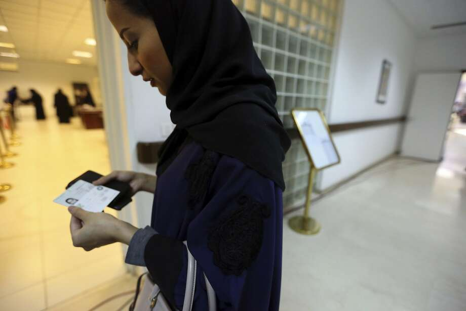 A woman casts a ballot in municipal elections in Riyadh, Saudi Arabia, the last major country to bar female voters. Photo: Aya Batrawy, Associated Press