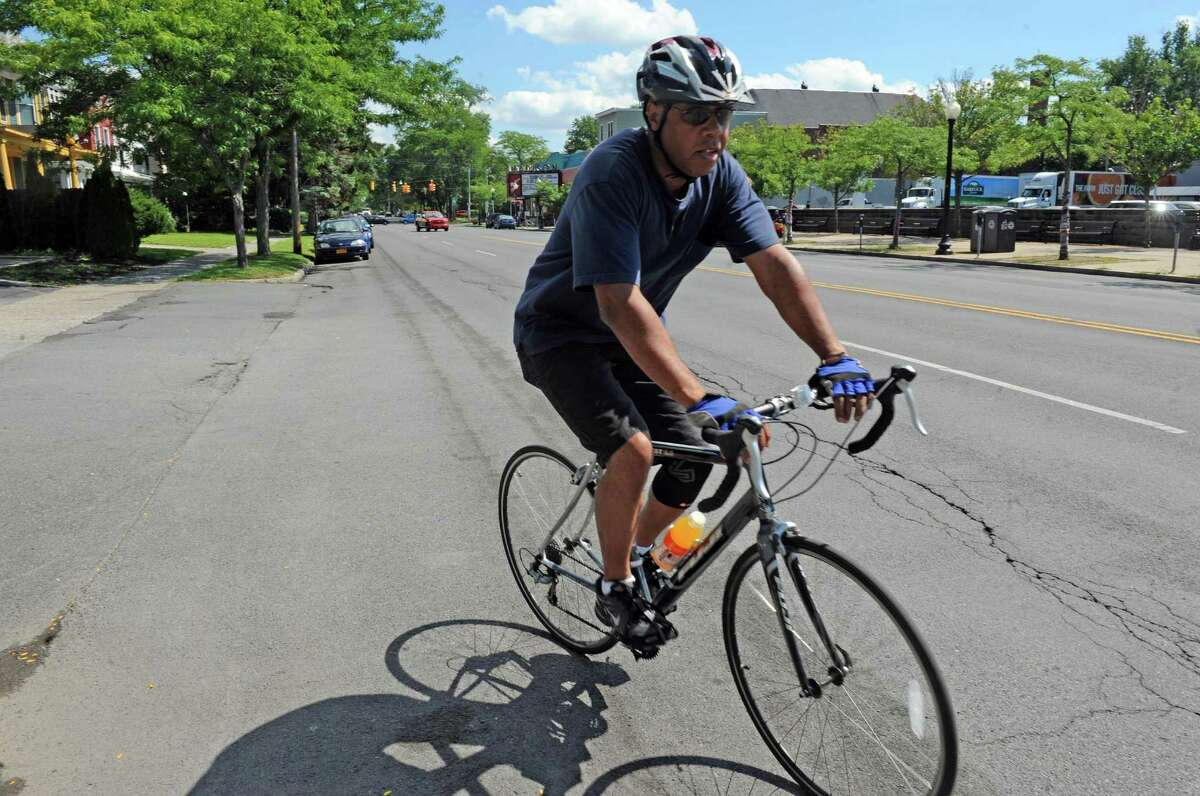 Don Kendricks of Albany bicycle on Madison Avenue on Friday Aug. 21, 2015 in Albany, N.Y. (Michael P. Farrell/Times Union)
