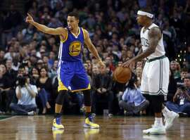 Golden State Warriors' Stephen Curry and Boston Celtics' Isaiah Thomas during NBA game at TD Garden in Boston, Massachusetts on Friday, December 11, 2015.