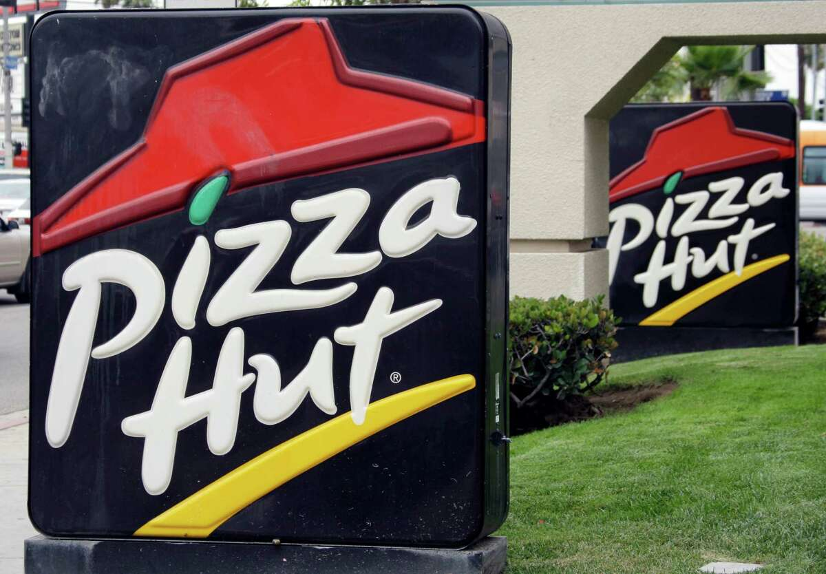FILE - This Oct. 5, 2010 file photo shows a Pizza Hut restaurant in Los Angeles Tuesday, Oct. 5, 2010. Yum CEO Greg Creed thinks he figured out why Pizza Hut can?'t shake its sales slump: The chain needs to be more like the car-hailing service Uber. ?