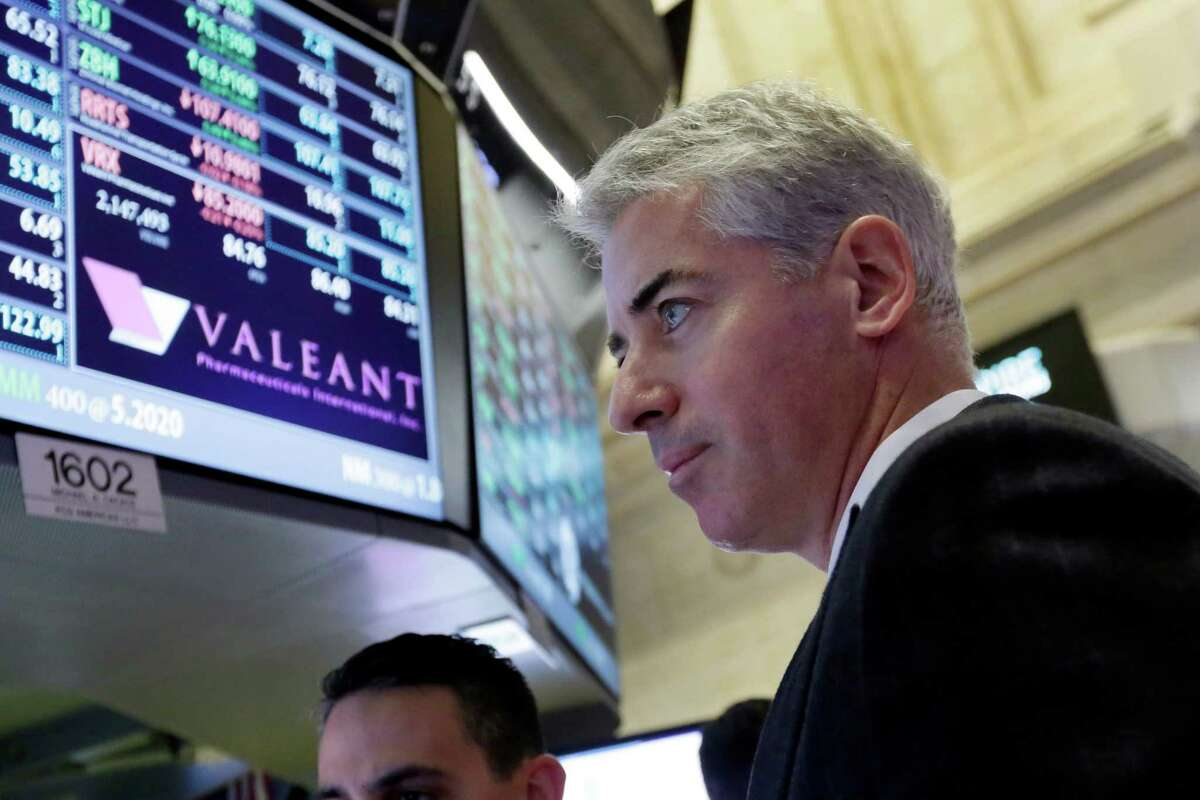 FILE - In this Nov. 10, 2015 file photo, Bill Ackman, CEO and founder of Pershing Square Capital and Valeant Pharmaceuticals' second largest shareholder, visits the company's trading post on the floor of the New York Stock Exchange. Ackman is one of the better-known activist investors because his campaigns are so aggressive and because he often makes his case publically. (AP Photo/Richard Drew) ORG XMIT: NY118