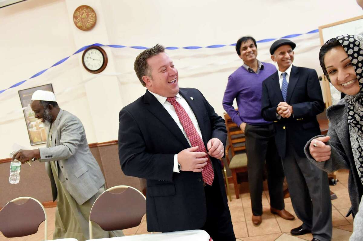 County Executive Daniel McCoy, center, shares a light moment with members of the Muslim community before hearing their concerns on Saturday, Dec. 12, 2015, at the Islamic Center of the Capital District in Colonie, N.Y. (Cindy Schultz / Times Union)