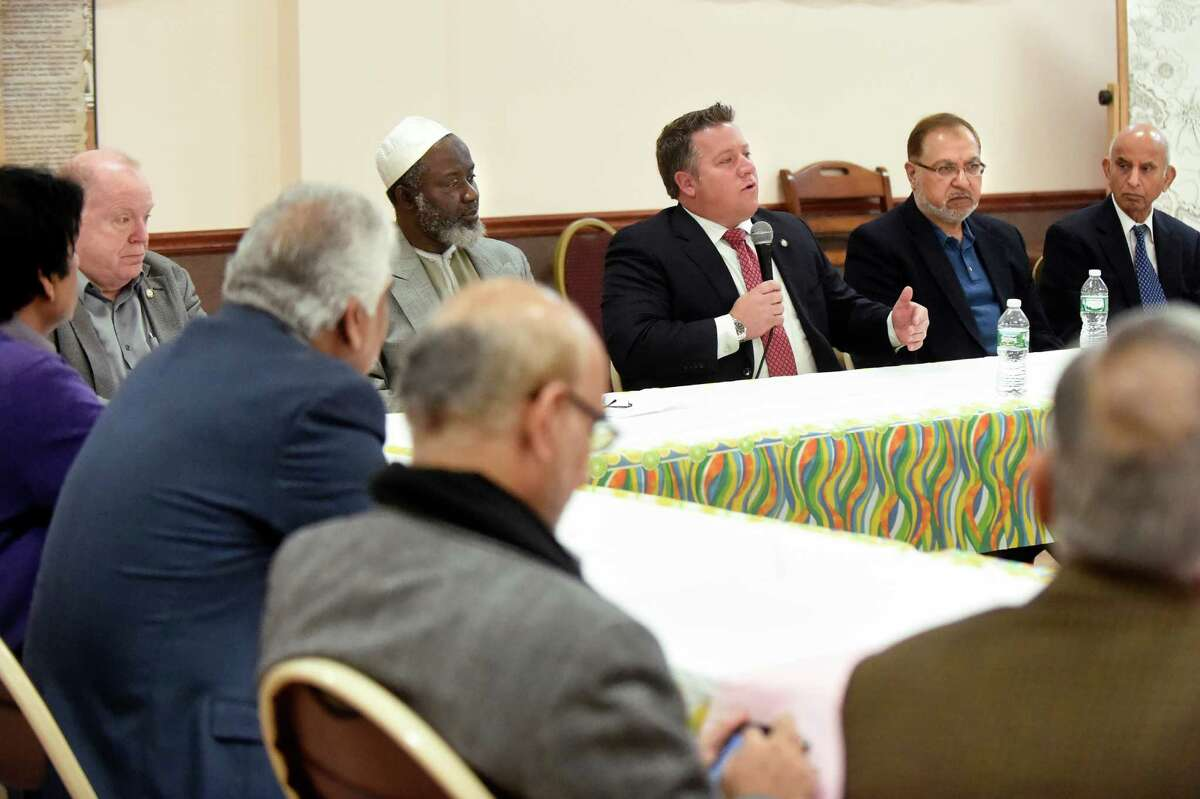 County Executive Daniel McCoy, center, speaks with members of the Muslim community on Saturday, Dec. 12, 2015, at the Islamic Center of the Capital District in Colonie, N.Y. (Cindy Schultz / Times Union)
