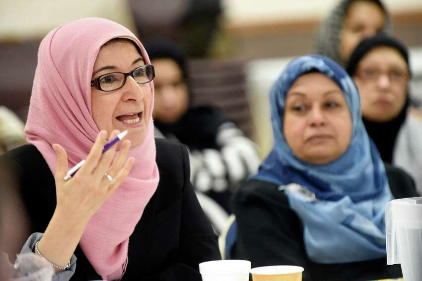 Mosque member Ilham AlMahamid, left, shares her concerns on Saturday, Dec. 12, 2015, at the Islamic Center of the Capital District in Colonie, N.Y. (Cindy Schultz / Times Union)