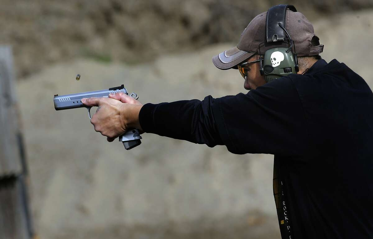 Ray Bala participates in an Action Pistol practice session event at the Richmond Rod and Gun Club in Richmond, Calif., on Saturday December 12, 2015.