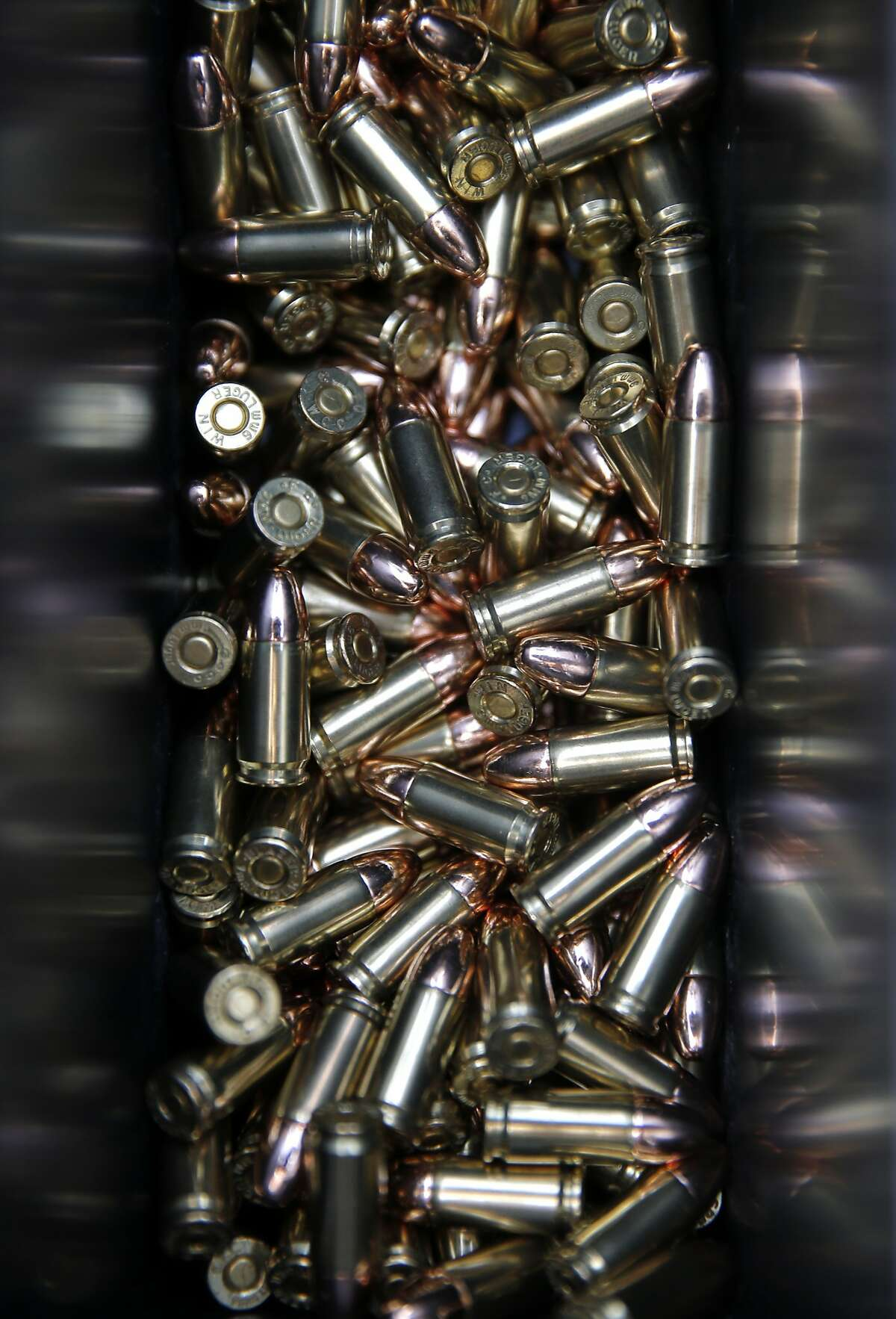 An Ammo box is filled with 9mm bullets as members participate in an Action Pistol practice event at the Richmond Rod and Gun Club in Richmond, Calif.on Saturday December 12, 2015.