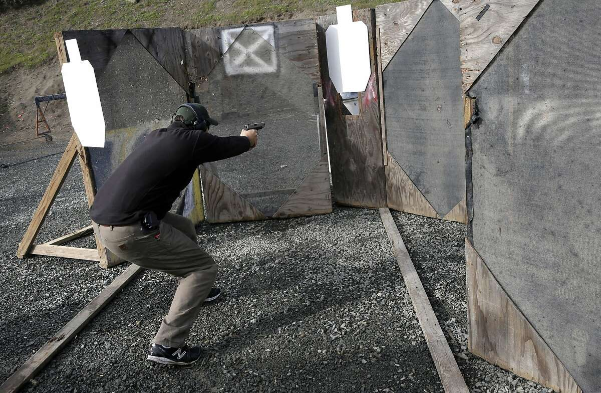 Brad Austin participates in an Action Pistol practice session event at the Richmond Rod and Gun Club in Richmond, Calif., on Saturday December 12, 2015.
