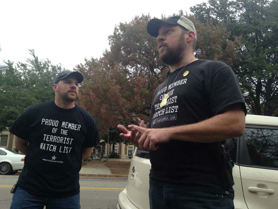 Pro-gun activists from Come and Take It Texas and DontComply.com staged a mock mass shooting  near the University of Texas at Austin on Saturday, Dec. 12, 2015. The groups said they wanted to demonstrate the dangers of gun-free zones. Murdoch Pizgatti, right, openly carried a handgun after the event. Photo: Lauren McGaughy, The Houston Chronicle
