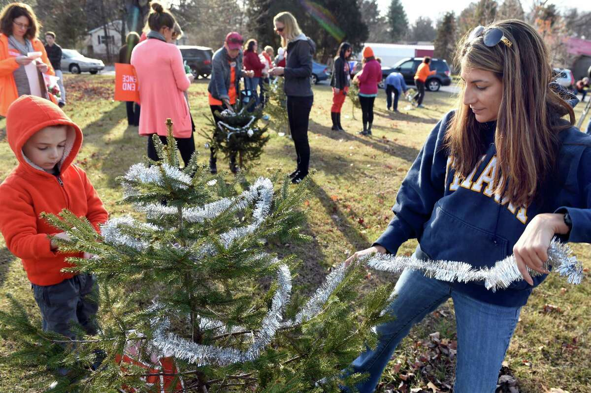 Mary Querbes of Wilton, right, and her son Grayson Querbes, 5, left, decorate a tree planted in memory of a victim of the Sandy Hook Elementary School shooting on Saturday, Dec. 12, 2015, at Sandy Hill Memorial Park in Wilton, N.Y. Moms Demand Action gathered to honor the 26 victims who died in the deadly mass shooting at the Sandy Hook Elementary School in Newtown, Conn. three years ago. (Cindy Schultz / Times Union)