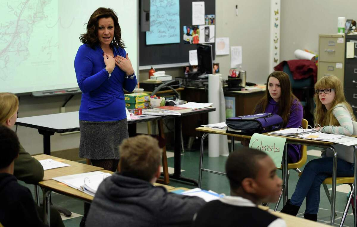 Teacher Stacey Muscato gets her class involved in a discussion of the contrast in thought between the Colonists and their British Governors in her social studies class at the Knickerbacker Middle School Wednesday Dec. 2, 2015 in Troy, N.Y. (Skip Dickstein/Times Union)