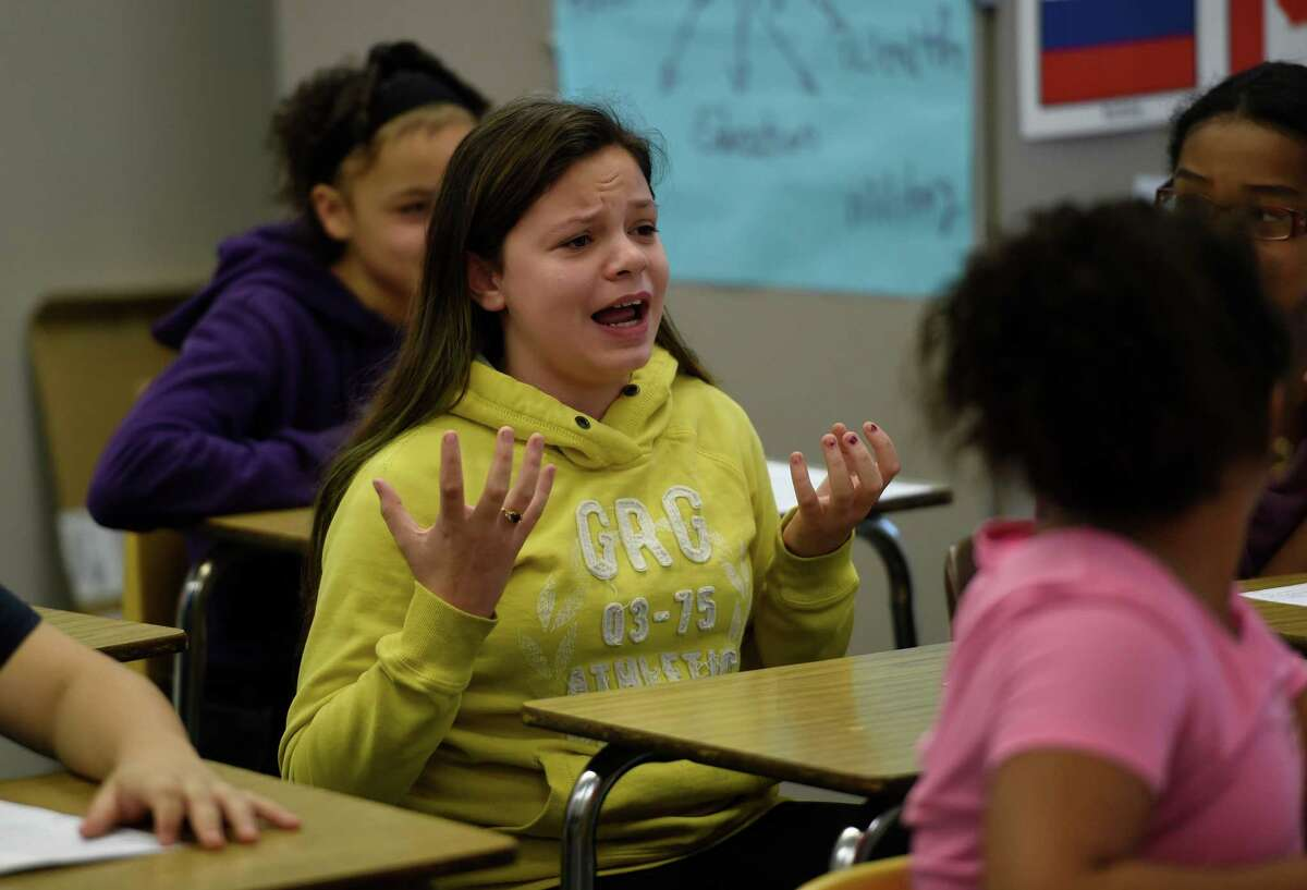 Isabella Damon gets animated during Mrs. Stacey Muscato's class discussion of the contrast in thought between the Colonists and their British Governors in her social studies class at the Knickerbacker Middle School Wednesday Dec. 2, 2015 in Troy, N.Y. (Skip Dickstein/Times Union)