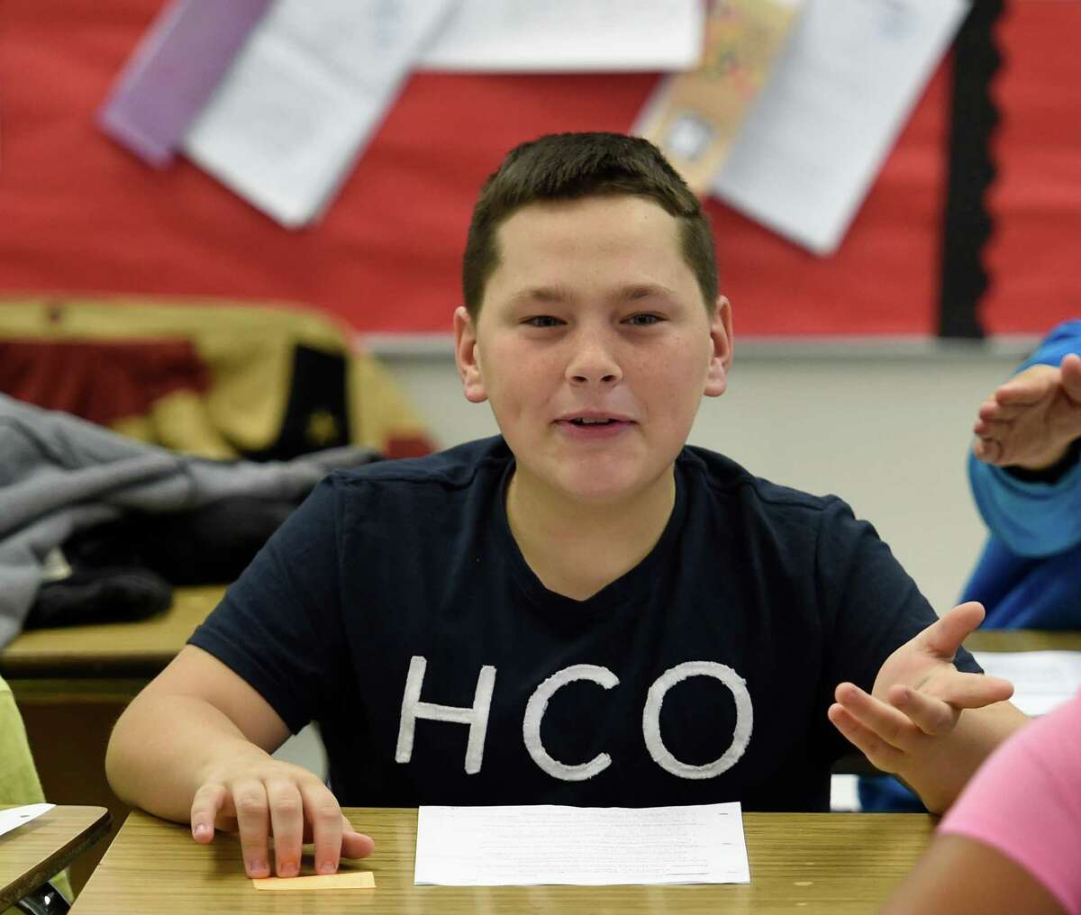 Chad LaBello voices his opinion during Mrs. Stacey Muscato's class discussion of the contrast in thought between the Colonists and their British Governors in her social studies class at the Knickerbacker Middle School Wednesday Dec. 2, 2015 in Troy, N.Y. (Skip Dickstein/Times Union)