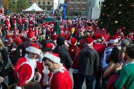Hundreds gather to celebrate SantaCon in Union Square on Saturday, Dec. 12, 2015 in San Francisco, Calif.