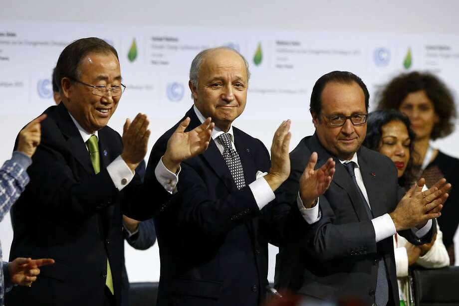 U.N. Secretary General Ban Ki-moon (left), French Foreign Minister Laurent Fabius and French President François Hollande applaud the adoption of the global climate agreement. Photo: Francois Mori, Associated Press