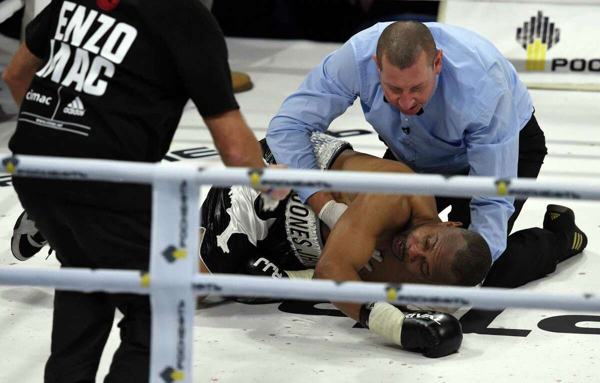 American-Russian boxer Roy Jones Jr. lies in the ring after being knocked out during the bout against British boxer Enzo Maccarinelli in Moscow on December 12, 2015. 46-year-old Roy Jones Jr. has knocked out in first bout as Russian citizen. / AFP / VASILY MAXIMOVVASILY MAXIMOV/AFP/Getty Images