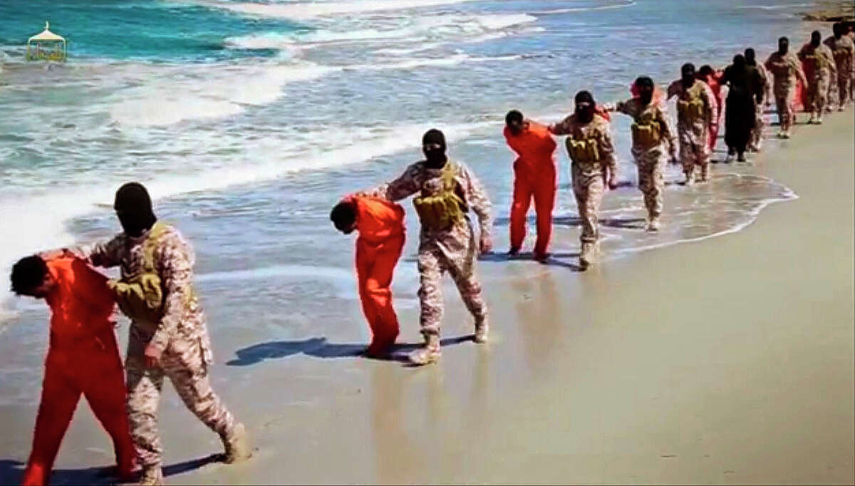 Members of an ISIS affiliate walk captured Ethiopian Christians along a beach in Libya before the captives were systematically executed.