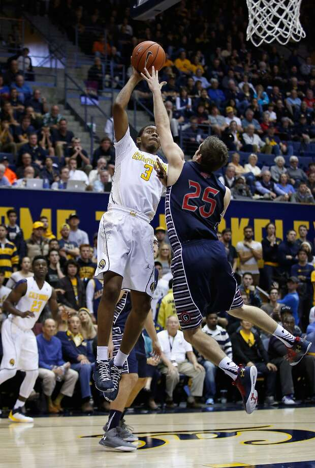 St. Mary's guard Joe Rahon leaps in an attempt to block a shot by Cal's Tyrone Wallace, who scored seven points. Photo: Ezra Shaw, Getty Images