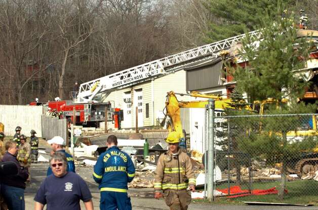 Firefighters respond to the scene of an explosion at 2 Allen Drive in Gaylordsville Thursday morning, April 1, 2010. Photo: Michael Duffy / The News-Times
