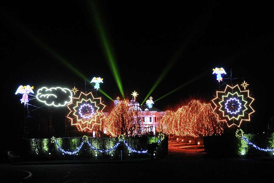 After going dark last year, the traditional holiday light show extravaganza is back at the Belle Haven mansion of Paul Tudor Jones II in the Belle Haven section of Greenwich, Conn., Thursday night, Dec. 10, 2015. Photo: Bob Luckey Jr. / Hearst Connecticut Media / Greenwich Time