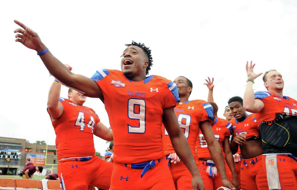 Sam Houston State wideout Yedidiah Louis (9) celebrates a 48-21 win over Colgate in an NCAA college football game in the quarterfinals of the Football Championship subdivision, Saturday, Dec. 12, 2015, in Huntsville, Texas. (Joshua Yates /The Huntsville Item via AP) MANDATORY CREDIT (REV-SHARE)