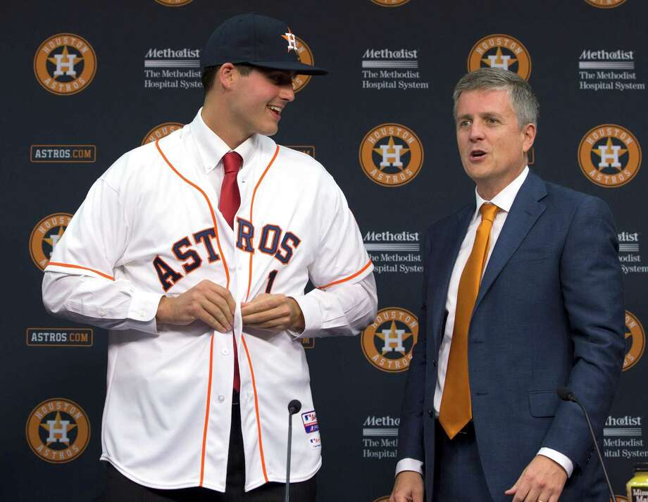 Astros GM Jeff Luhnow, right, made Mark Appel the middle of three straight No. 1 picks from 2012-14. Photo: David J. Phillip, STF / AP