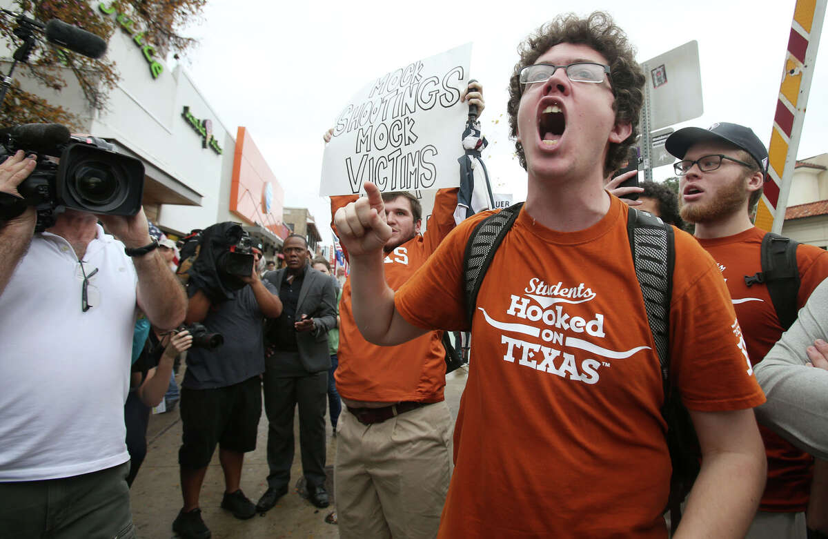Counter protester Graham Houpt yell towards supporters of ending gun-free zones on college campuses march near the University of Texas at Austin Saturday, Dec. 12, 2015.