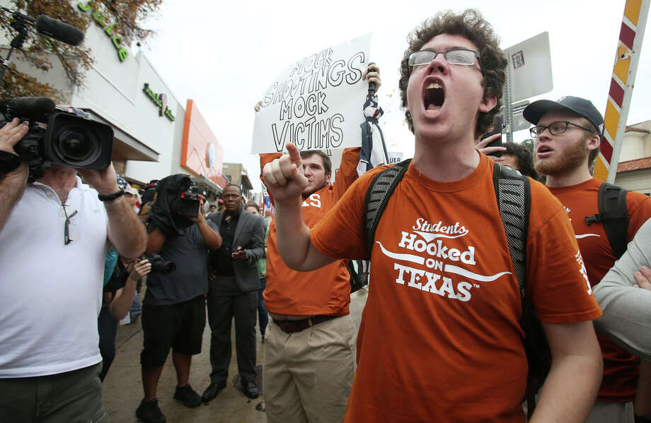 Counter protester Graham Houpt yell towards supporters of ending gun-free zones on college campuses march near the University of Texas at Austin Saturday, Dec. 12, 2015. Photo: Stephen Spillman