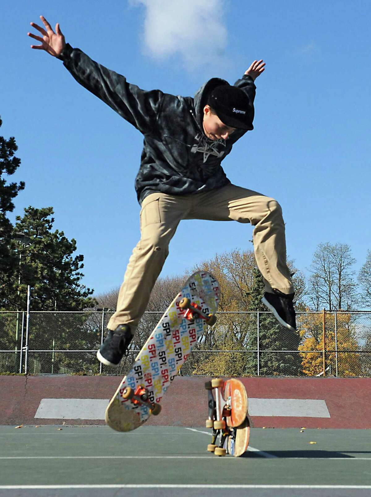 Skateboarder Anthony Defrancesco, 14, of Rensselaer works on his moves at the dilapidated tennis courts in Washington Park on Tuesday, Nov. 11, 2014 in Albany, N.Y. These four dilapidated tennis courts in Washington Park could become the city's first public skateboard park. The Recreation Department is soliciting public input on that possibility - as well as suggestions for other potential sites - starting Thursday night at a public session from 6 p.m. to 8 p.m. at Bleecker Stadium. (Lori Van Buren / Times Union) ORG XMIT: MER2015121114341030