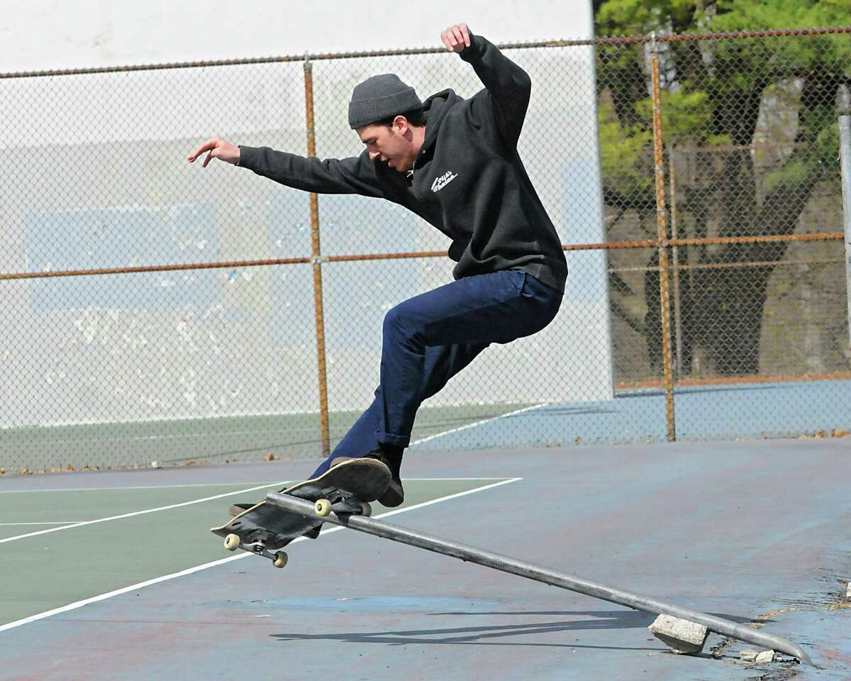 Dakota Rice of Albany grinds a rail on his skateboard in Washington Park on Thursday, April 23, 2015 in Albany, N.Y. (Lori Van Buren / Times Union) ORG XMIT: MER2015042315431803