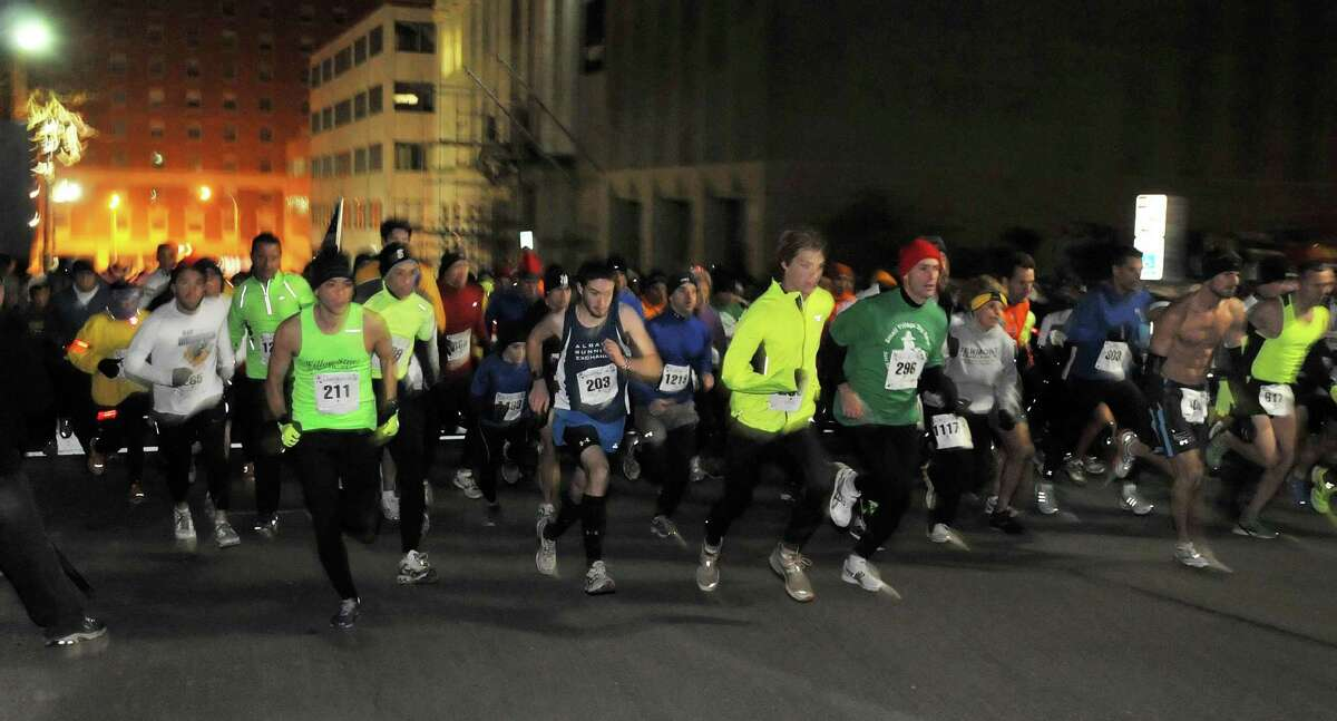 Runners at the start of the 15th Annual Last Run 5K race in Albany Saturday Dec. 17, 2011. (John Carl D'Annibale / Times Union)