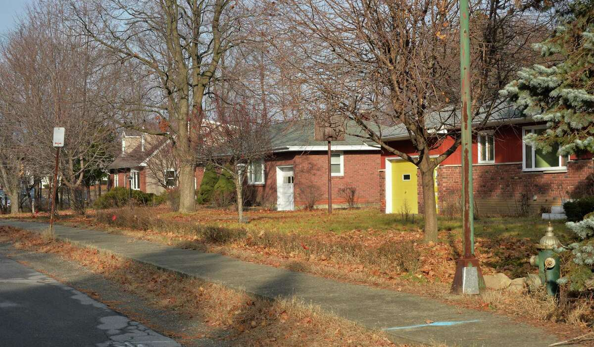 Houses slated for demolition along Loughlin Street Friday Dec. 11, 2015 in Albany, NY. (John Carl D'Annibale / Times Union)