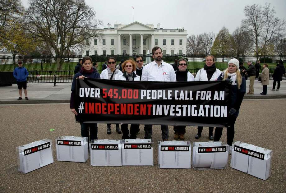Doctors Without Borders supporters outside the White House on Wednesday have petitions seeking an independent probe of the mistake in Afghanistan. Photo: Carolyn Kaster /Associated Press / AP