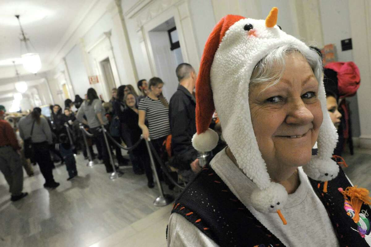 Pat Rejack of Schenectady waits in line to visit Santa during the Downtown Schenectady?'s City Hall-iday on Saturday Dec. 12, 2015 in Schenectady, N.Y. (Michael P. Farrell/Times Union)