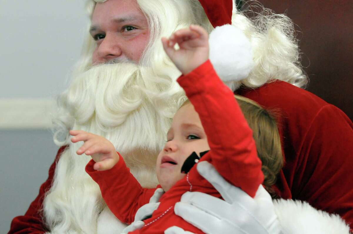 Two-year-old Arianna Vasquez of Schenectady was not happy with her vist with Santa during the Downtown Schenectady?'s City Hall-iday on Saturday Dec. 12, 2015 in Schenectady, N.Y. (Michael P. Farrell/Times Union)