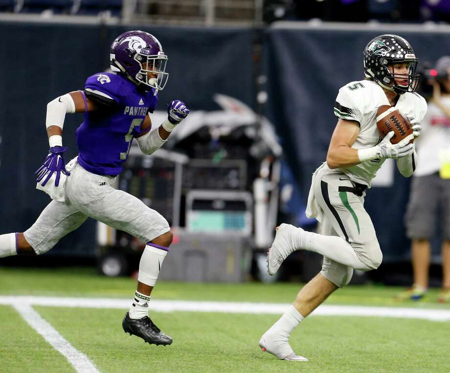 Cedar Park's Tommy Lavine, right, beats Ridge Point's Ar'mani Johnson on a catch-and-run for a 47-yard touchdown in the second quarter of Saturday's game. Photo: Karen Warren, Staff / © 2015  Houston Chronicle