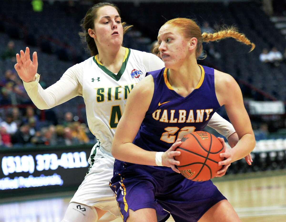 Siena's #4 Emia Willingam, left, covers UAlbany's #22 Heather Foster during Saturday's game at the Times Union Center Dec. 12, 2015 in Albany, NY. (John Carl D'Annibale / Times Union)