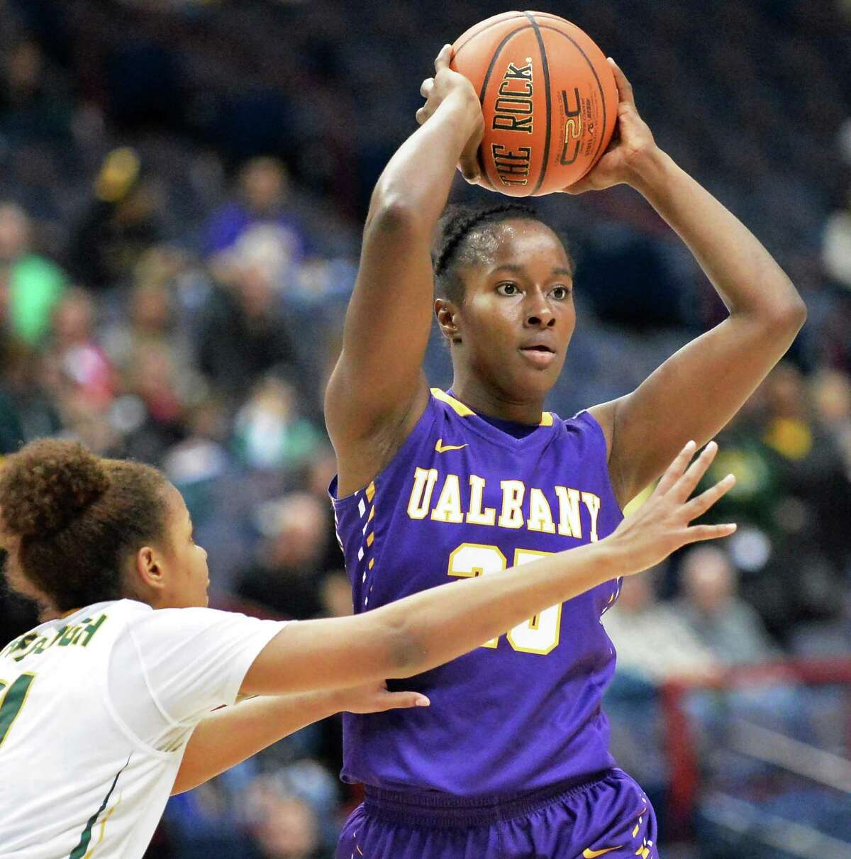 Siena's #21 Kollyns Scarbrough, left, covers UAlbany's #25 Shereesha Richards during Saturday's game at the Times Union Center Dec. 12, 2015 in Albany, NY. (John Carl D'Annibale / Times Union)