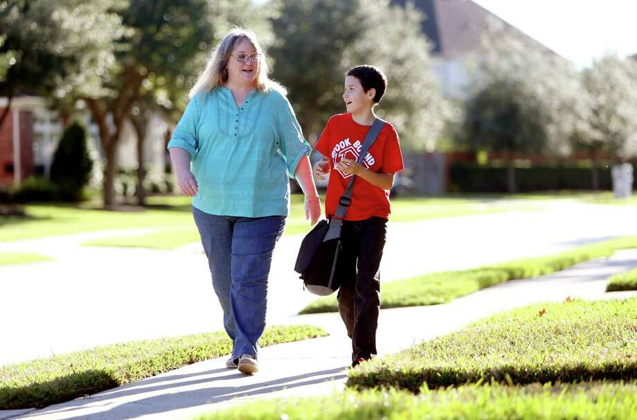 Ann Elder picks up her 10-year-old transgender son, Benjamin, after school in Friendswood. Elder was told by a pediatric psychologist at Texas Children's Hospital that her daughter Marissa, now Ben, was gender variant at age 6. Photo: Gary Coronado, Staff / © 2015 Houston Chronicle