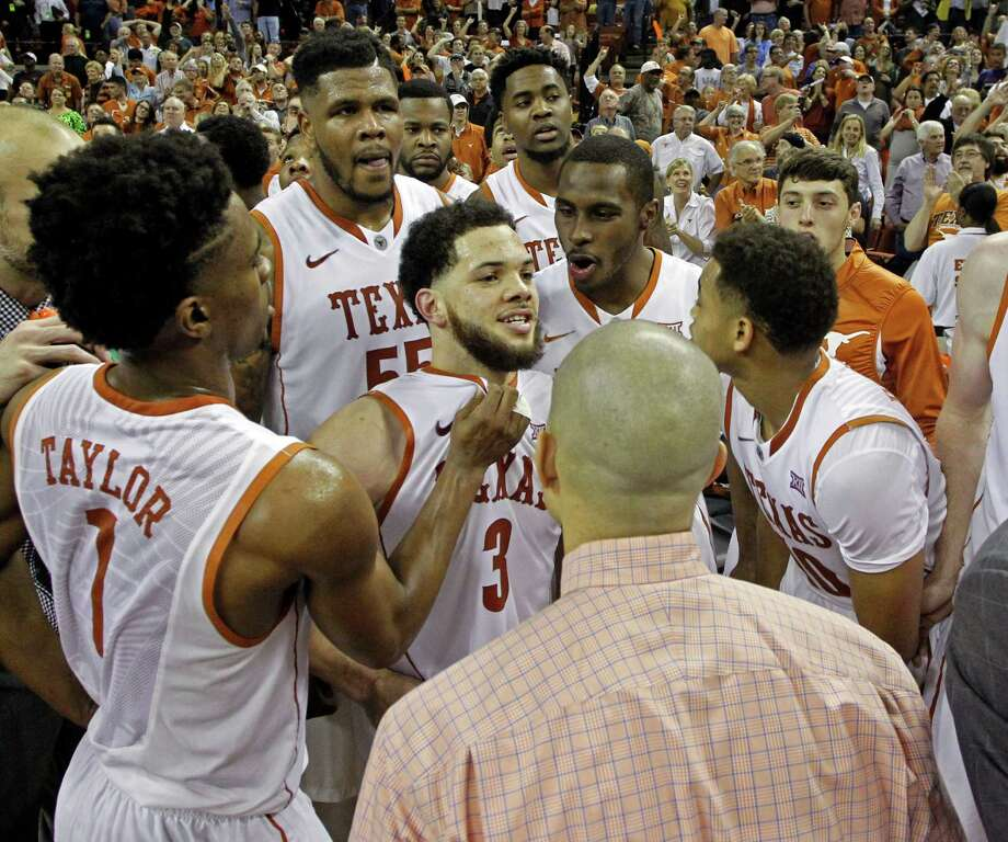 Texas head coach Shaka Smart, front, waits for the official review of the last shot with Javan Felix, center, and players, from left to right, Isaiah Taylor, Cameron Ridley, Prince Ibeh, Kendal Yancy, and Eric Davis II, after defeating North Carolina on Dec. 12 in Austin. Texas won 84-82. Photo: Michael Thomas /Associated Press / FR65778 AP