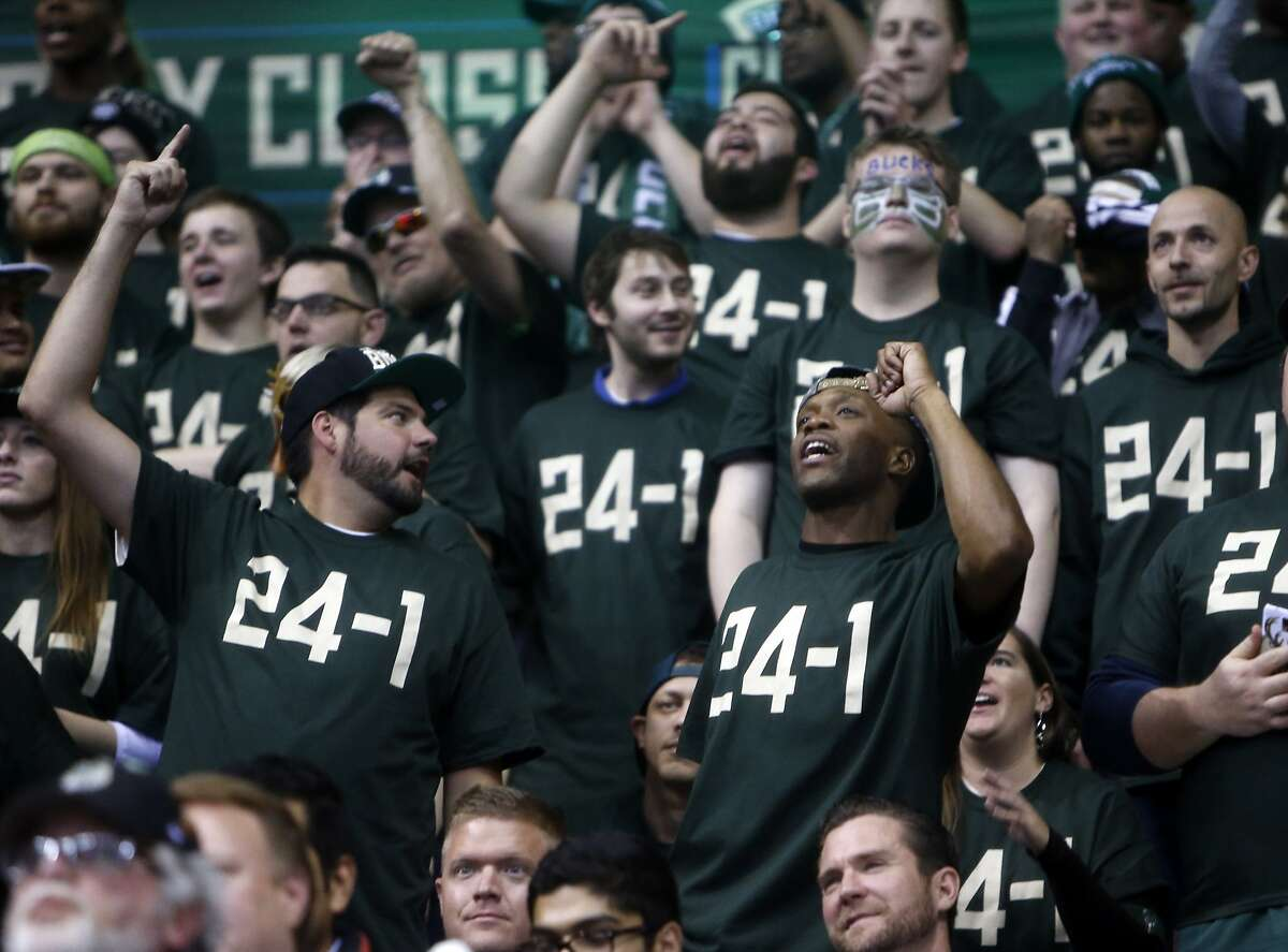 Milwaukee Bucks' fans wear 24-1 shirts as their team plays Golden State Warriors during NBA game at BMO Harris Bradley Center in Milwaukee, WI on Saturday, December 12, 2015.