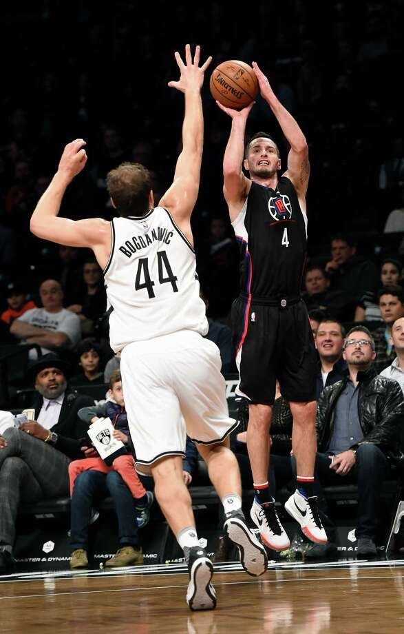 Los Angeles Clippers guard J.J. Redick (4) takes aim for the basket over Brooklyn Nets guard Bojan Bogdanovic (44) during the first half of an NBA basketball game on Saturday, Dec. 12, 2015, in New York. (AP Photo/Kathy Kmonicek) Photo: Kathy Kmonicek, FRE / FR170189 AP