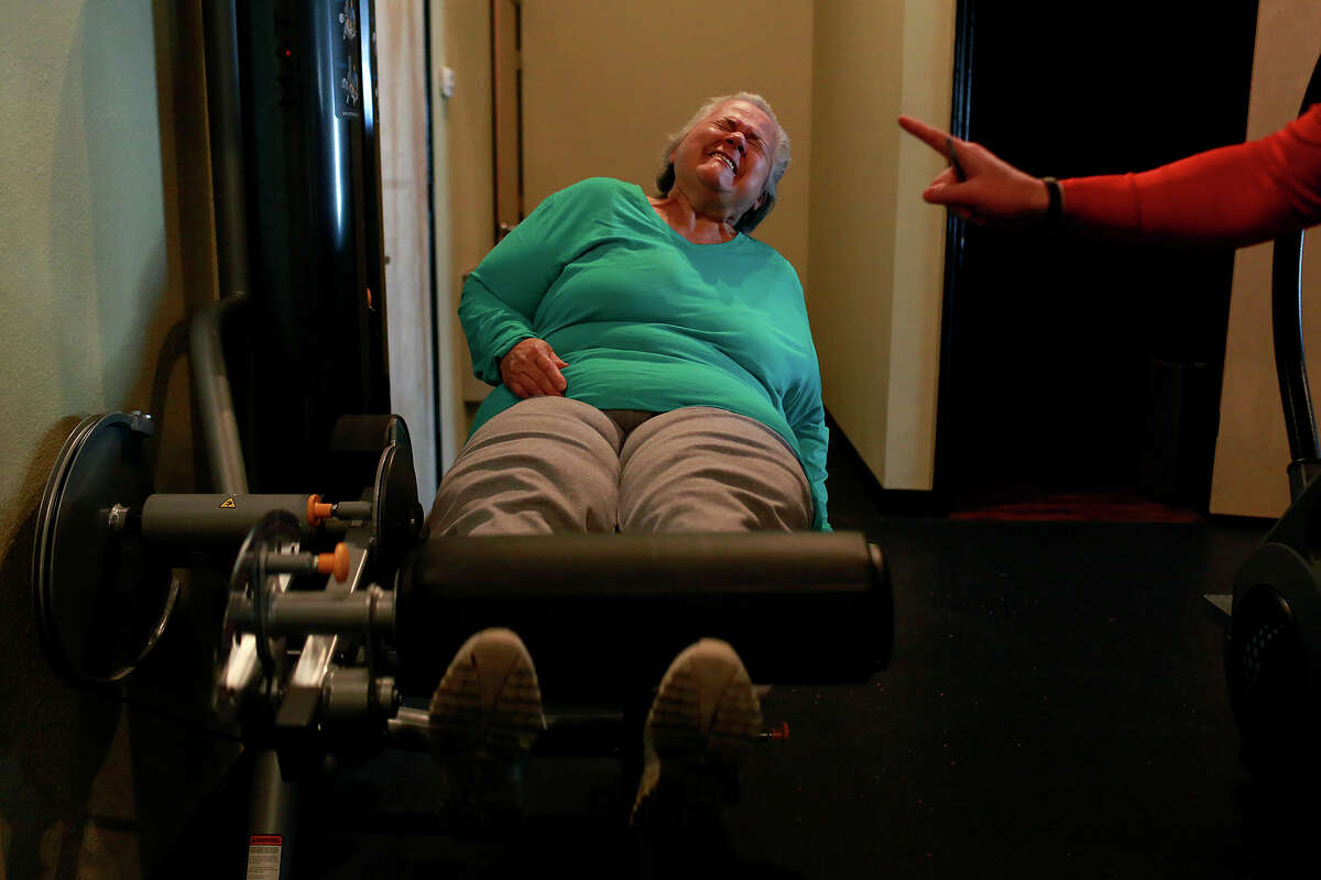 Elena Garcia exercises for the second time with Fit Therapy of Texas co-owner Kenny McClendon in San Antonio on Feb. 19, 2015. Before going to Fit Therapy, Garcia had never exercised.