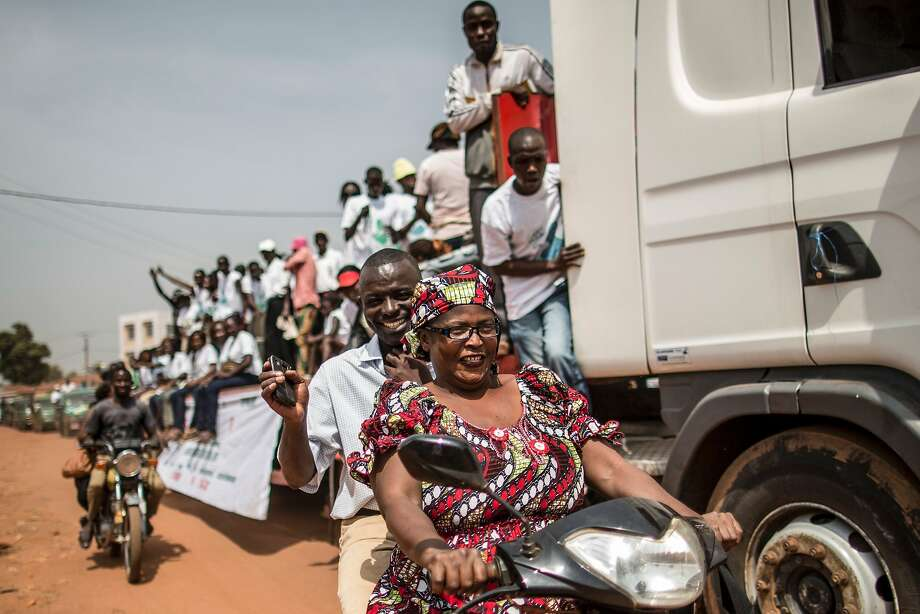 Supporters of the President of the National Council for Transition in Central African Republic Alexandre-Ferdinand N'Guendet, a presidential candidate, parade on a truck through the streets of Bangui on December 12, 2015.