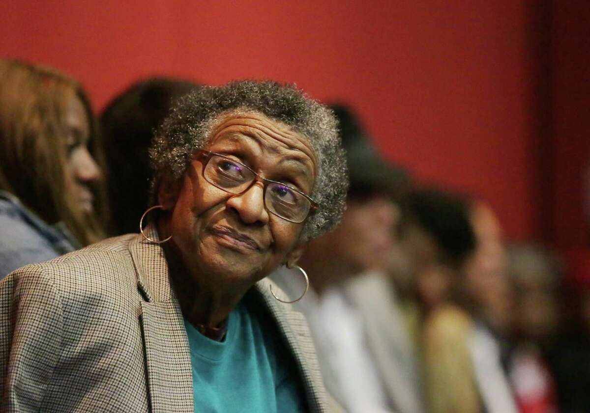Dr. Anita Spivey, part of the Texas Organizing Project, watches election results come in at the Sylvester Turner election night watch party at the George R. Brown Convention Center, Saturday, Dec. 12, 2015, in Houston.